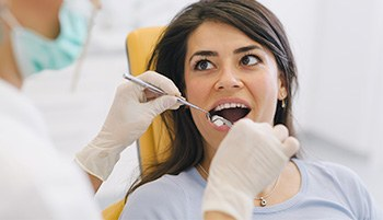 Woman receiving tooth removal treatment