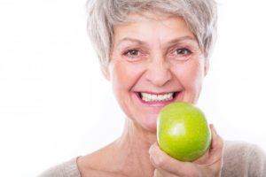 woman apple smiling